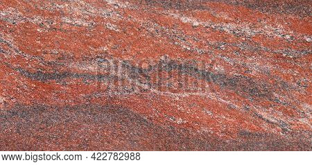 Closeup Of A Granite Stone Surface. Red, White And Black Texture Of A Polished Natural Crystalline R