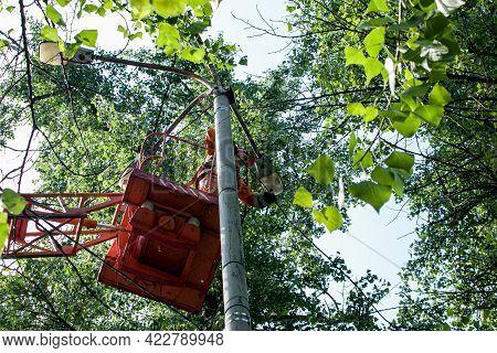 Dnepropetrovsk, Ukraine - 05.27.2021: A Municipal Worker In Protective Equipment Performs Hazardous