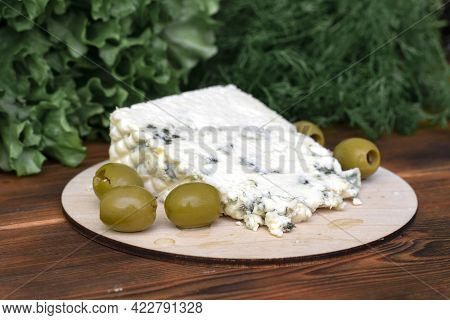 Cheese With A Noble Blue Mold, Cooked From Cow's Milk.