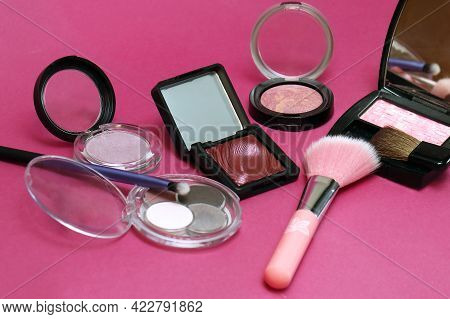 Pink Shade Beauty Makeup Eyeshadows And Blushes For Face On Purple Background