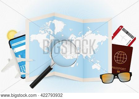 Travel Destination Guinea, Tourism Mockup With Travel Equipment And World Map With Magnifying Glass