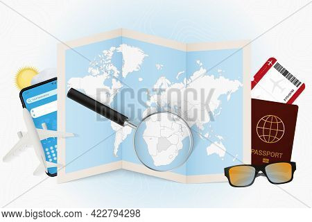 Travel Destination Botswana, Tourism Mockup With Travel Equipment And World Map With Magnifying Glas