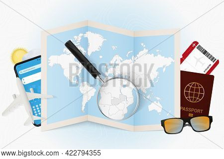 Travel Destination Zambia, Tourism Mockup With Travel Equipment And World Map With Magnifying Glass