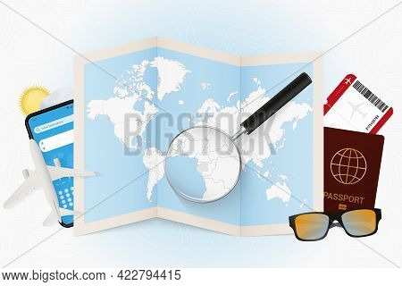 Travel Destination Gabon, Tourism Mockup With Travel Equipment And World Map With Magnifying Glass O