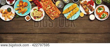 Summer Bbq Grill Top Border Over A Dark Wood Banner Background. Grilled Flatbread, Chicken And Shrim