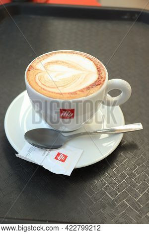 Barcelona, Spain - September 29th 2019: Illy Cappuccino In A Branded Coffee Cup With Illy Sugar And