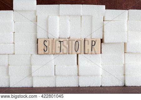 Pile Or Wall Of Sugar Cubes And Stop Word In Block Letters As Advise On Addiction Calories Excess An
