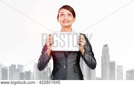Businesswoman Holding Tablet Computer With Blank Screen. Smiling Woman In Business Suit Show Tablet