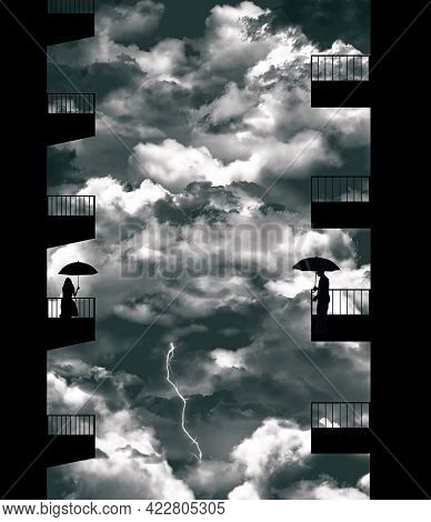 A Man On His Apartment Balcony Is Seen Across From A Woman On Her Balcony. Both Have Umbrellas As A