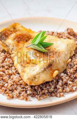 fried carp with bulgur and mint