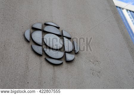 Ottawa, Ontario, Canada - June 4, 2021: The Logo For The Canadian Broadcasting Corporation On A Conc