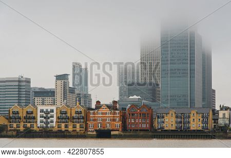 Skyline Of Canary Wharf Business Centre At Mist In London United Kingdom