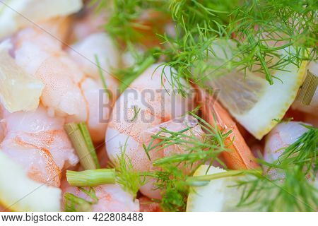 Cooking In Tandoor. Peeled Shrimps, Lemon, Dill, On A Platter. Recipe Concept, Cooking Secrets.