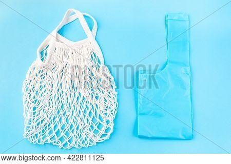 Mesh Bag Vs Plastic Bag On A Blue Background, Zero Waste Or Plastic Free Concept, Horizontal, Top Vi