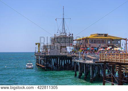 Santa Monica, Ca, Usa - June 20, 2013: End Of Pier Over Azure Ocean With Marisol Restaurant Building