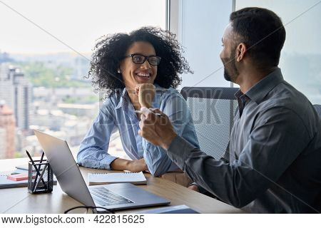 Cheerful Happy Multiethnic Colleagues Male Indian And Mixed Race Female Sitting At Desk With Laptop