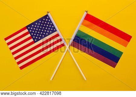 Rainbow Flag Lgbt And Usa Flag Against The Yellow Background. Lgbt Pride Month. Lgbtq. Lgbtqia. Clos