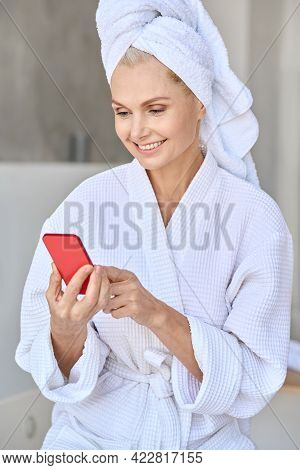 Vertical Portrait Of Happy Smiling Beautiful Middle Aged Woman Wearing Bathrobe And Towel On Head Us