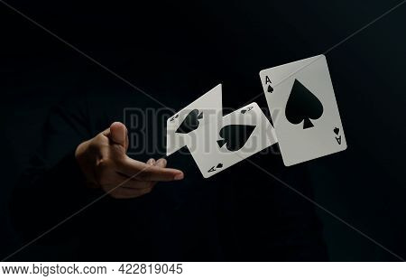 Ace Spade Playing Card. Player Or Magician Flick And Levitating Poker Card By Hand. Front View. Clos