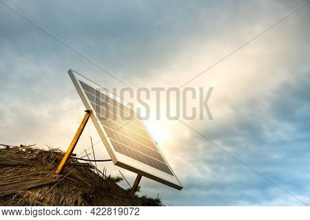 Small Solar Cell Panel On The Roof. Making Solar Power In Outback Farmhouse. Ecology Care By Green E