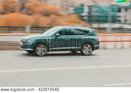 Moscow, Russia - May 2021: Green Premium Class Suv Genesis Gv80 At The City Street In Motion