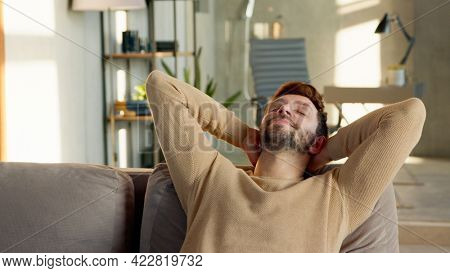Young male relaxes on the sofa in a calm atmosphere alone