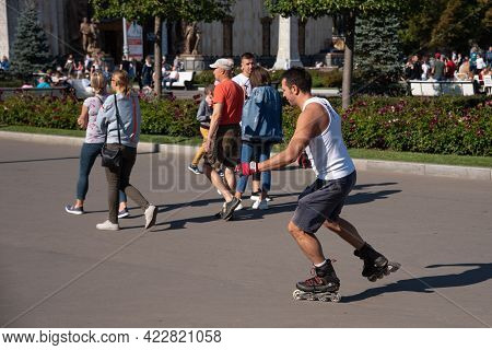 Moscow, Russia, August 29, 2019 - An Ordinary City Life, A Young Man Is Rollerblading Along A City S