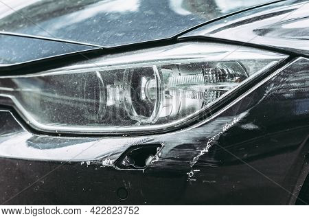 Close Up View Of Scratches And Damage To The Bumper Of Auto. Car Damage Insurance Concept. Repair Of