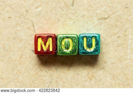 Metallic Color Alphabet Letter Block In Word Mou (abbreviation Of Memorandum Of Understanding) On Wo
