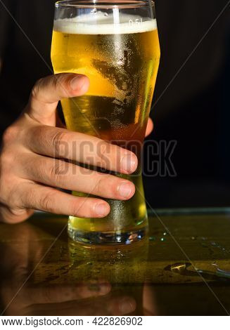 Beer Mugs. Man Hand Hold Cup Glass Of Beer.