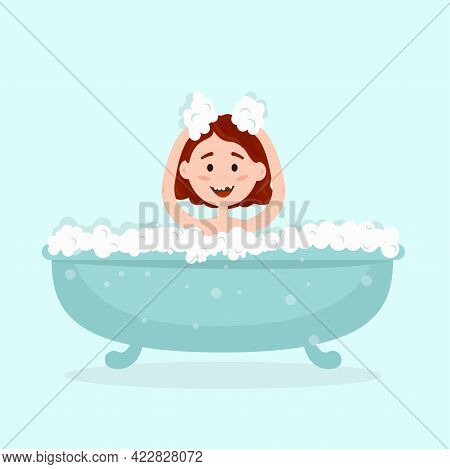 A Little Happy Girl Bathing In A Bathtub With Bubbles