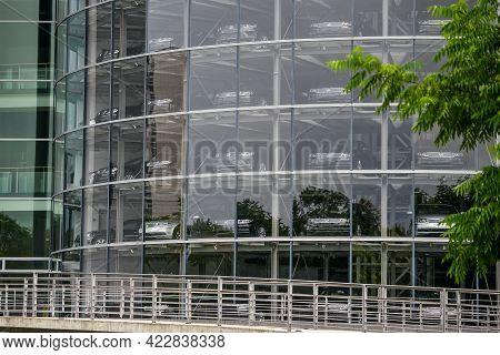 Germany Dresden - August 2015: Glaeserne Manufaktur. Glass Manufactory Volkswagen. Car In A Showroom