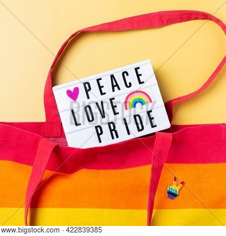Peace Love Pride Text, Rainbow Reusable Bag Against Yellow Background