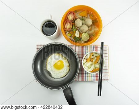 Omelet, Pickled Cucumber Meatballs And Meatball Soup On A Napkin On A White Background.