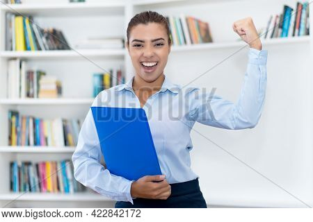 Cheering Hispanic Female Business Trainee At Office Of Company