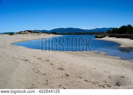 View Of The Coghinas River In The Pirotti Li Frati Beach