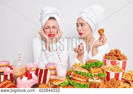 Puzzled Asian Woman With Red Lips Looks At Her Crying Friend Asks What Happened Holds Fried Chicken