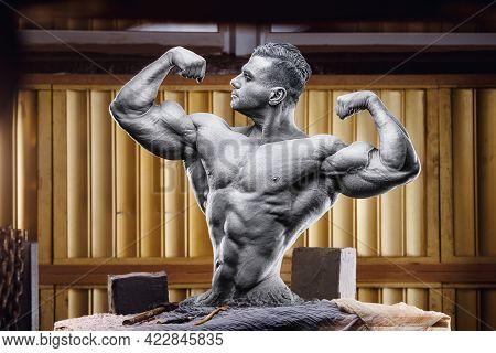 Athletic Bodybuilder Statue On Sculptor's Desk In Workshop Studio. Body Sculpting. Self Made Man. Ol