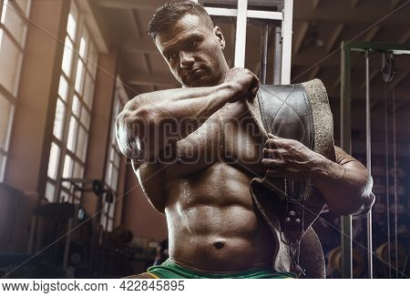 Old Fashion Bodybuilder Doing Exercises In Old School Gym. Handsome Caucasian Sports Man Style Of Th