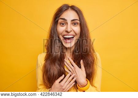 Excited Happy European Woman With Natural Long Hair Smiles Broadly Hears Excellent News Smiles Broad