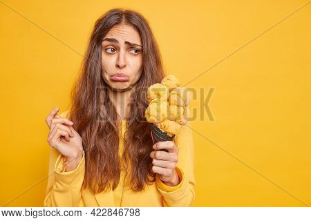 Upset Dejected Brunette Woman Purses Lips Frowns Face Stands Troubled Holds Delicious Cone Ice Cream
