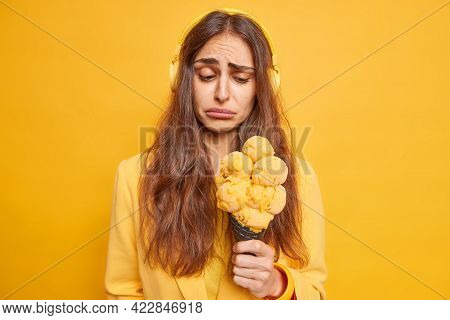 Frustrated Unhappy Brunette Woman Looks Sadly At Delicious Tasty Cone Ice Cream Listens Music Via He