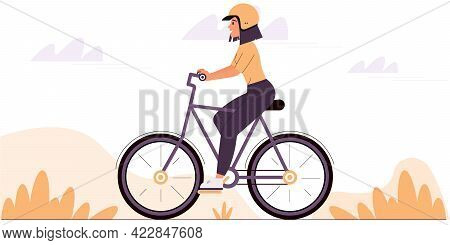 Young Woman Wearing A Protective Helmet Rides A Bicycle. The Concept Of A Healthy Lifestyle. Colorfu