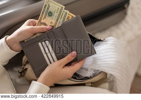 Female Hands Holding Cash Money Dollars In Wallet With Cards Ready Travel Vacation Or Business Trip