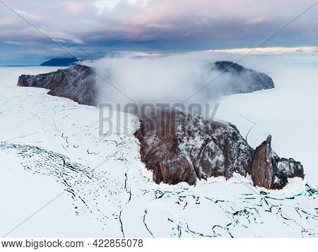 Aerial Drone View Of Cape Khoboy Of Olkhon Island, Baikal, Siberia, Russia. Fog Over The Island At S