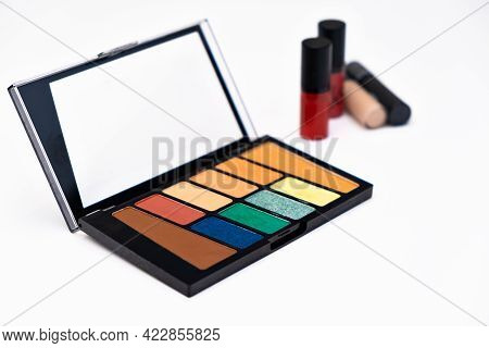 Colourful Eyeshadow Makeup Palette Isolated On White Background With Lipstiks. Make Up Artist Tools