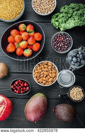Organic Food For Healthy Nutrition, Superfoods, Flat Lay, On Black Wooden Background.