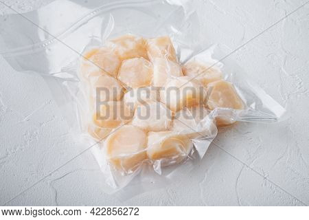 Frozen Meat Scallops In Vacuum Package, On White Textured Background