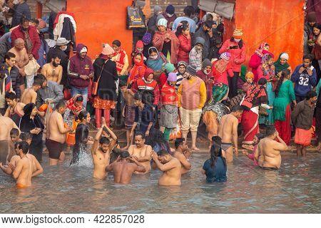 Haridwar, Uttarakhand, India, April 14, 2021. Pilgrims Holy Dip In River Ganges, The Home Of Pilgrim