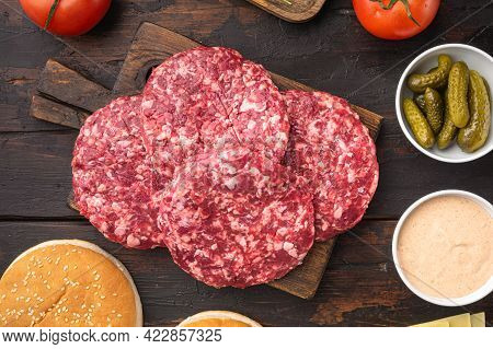 Patty Of Minced Meat For Burger Set, On Old Dark  Wooden Table Background, Top View Flat Lay